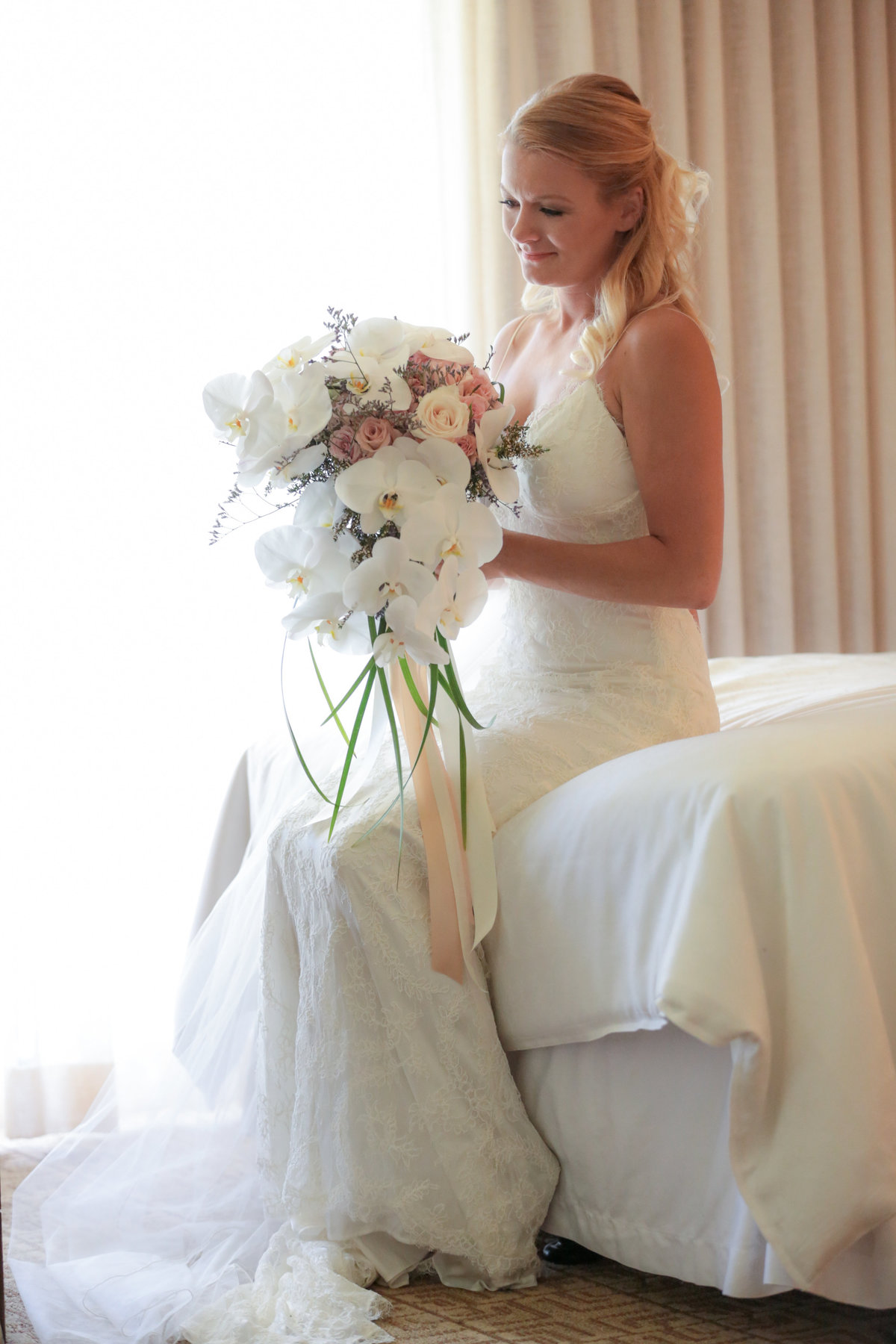 Bradenton-Sarasota Wedding Photography of the bride with her bouquet