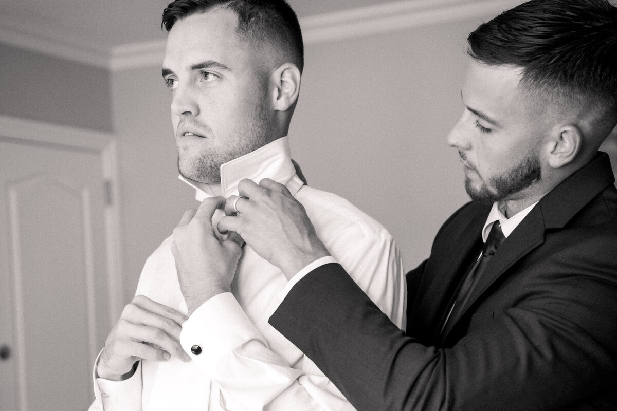 Best Man putting on tie