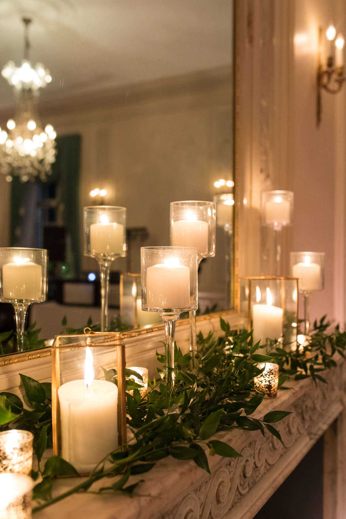 Candles decorate the mantel at Glen Manor during the wedding reception