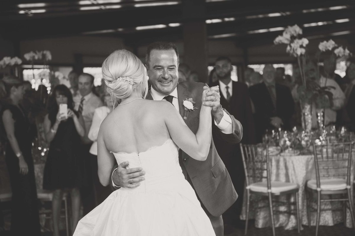 Bride and groom dancing in black and white at Huntington Crescent Club