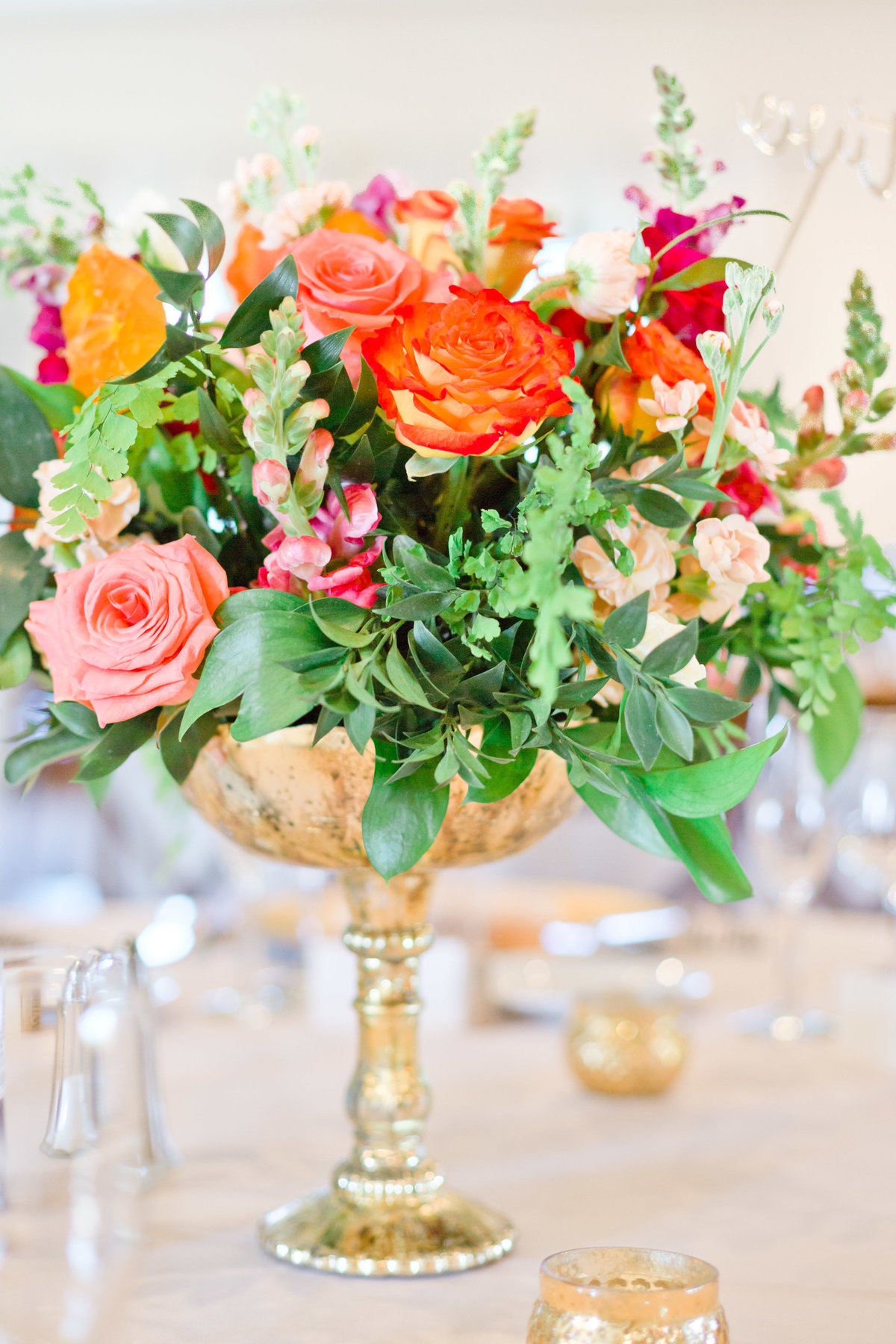 wedding centerpiece gold accent roses in spring flowers