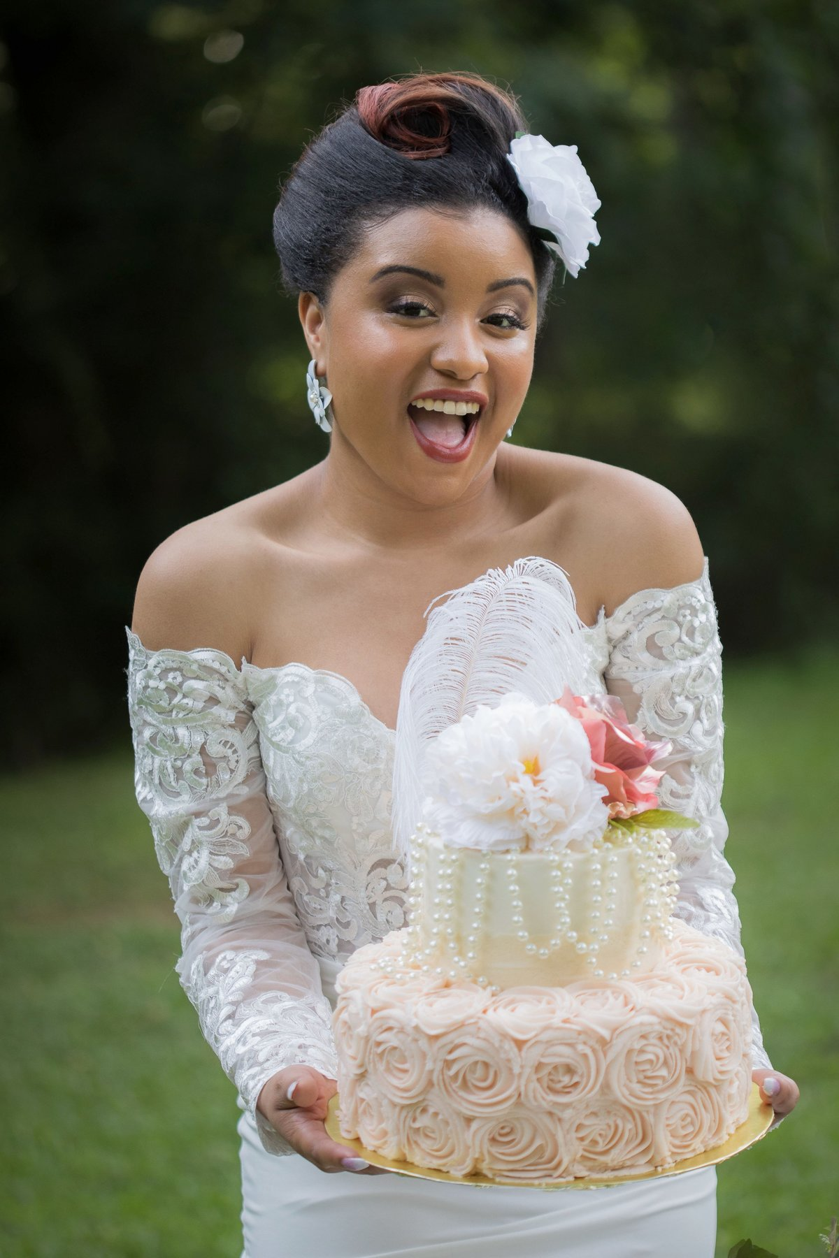 bride holding wedding cake