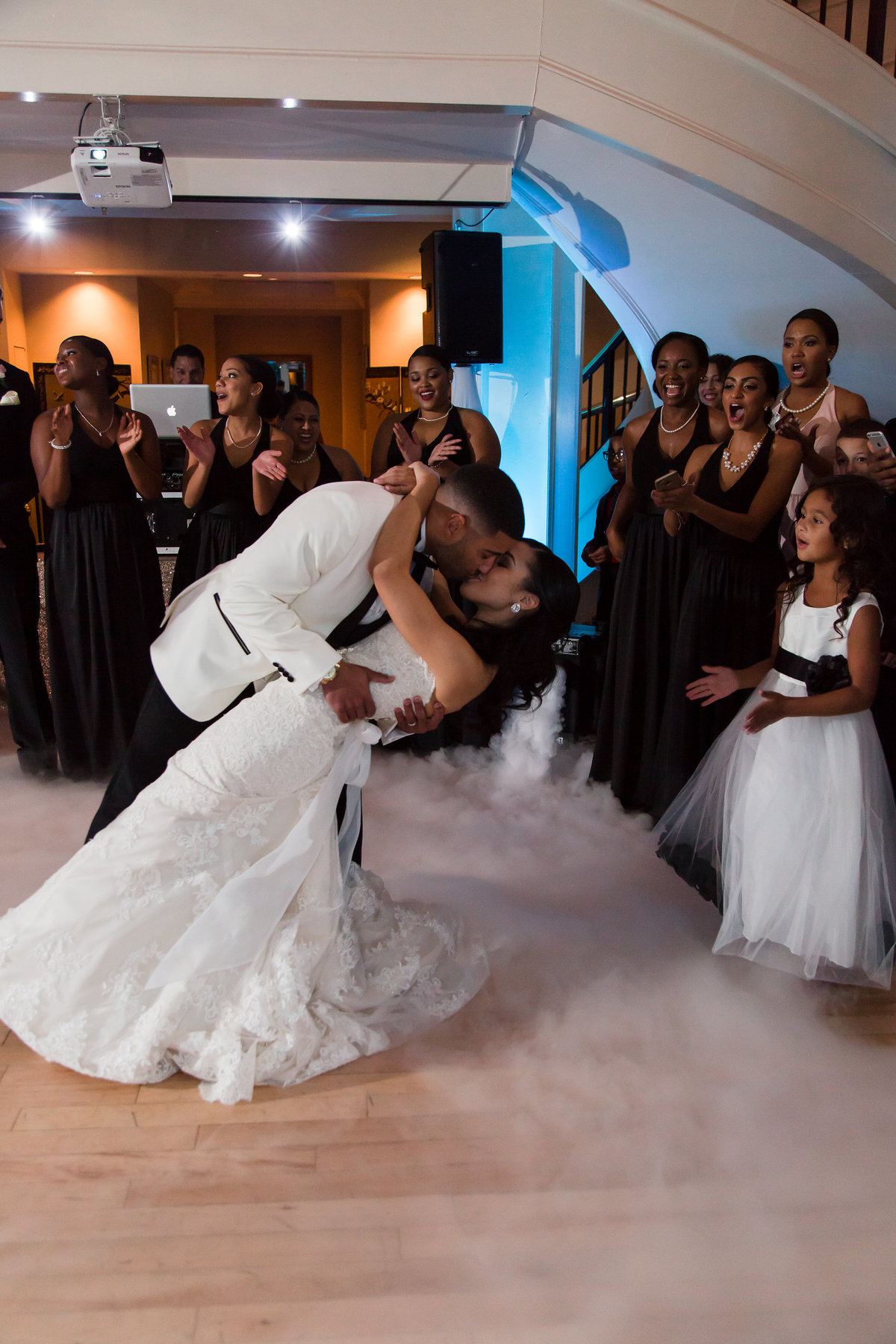 A groom dips his bride for a kiss at The Dominion Club in Richmond