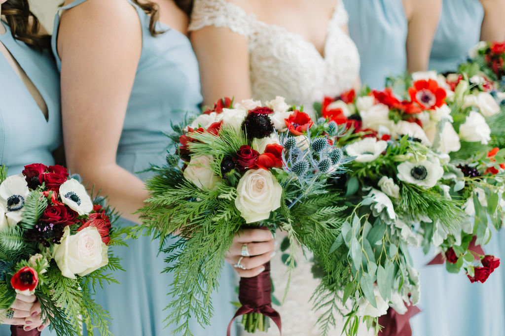 Stunning bridal bouquets with red green and blue / Tyler Rosenthal Photography