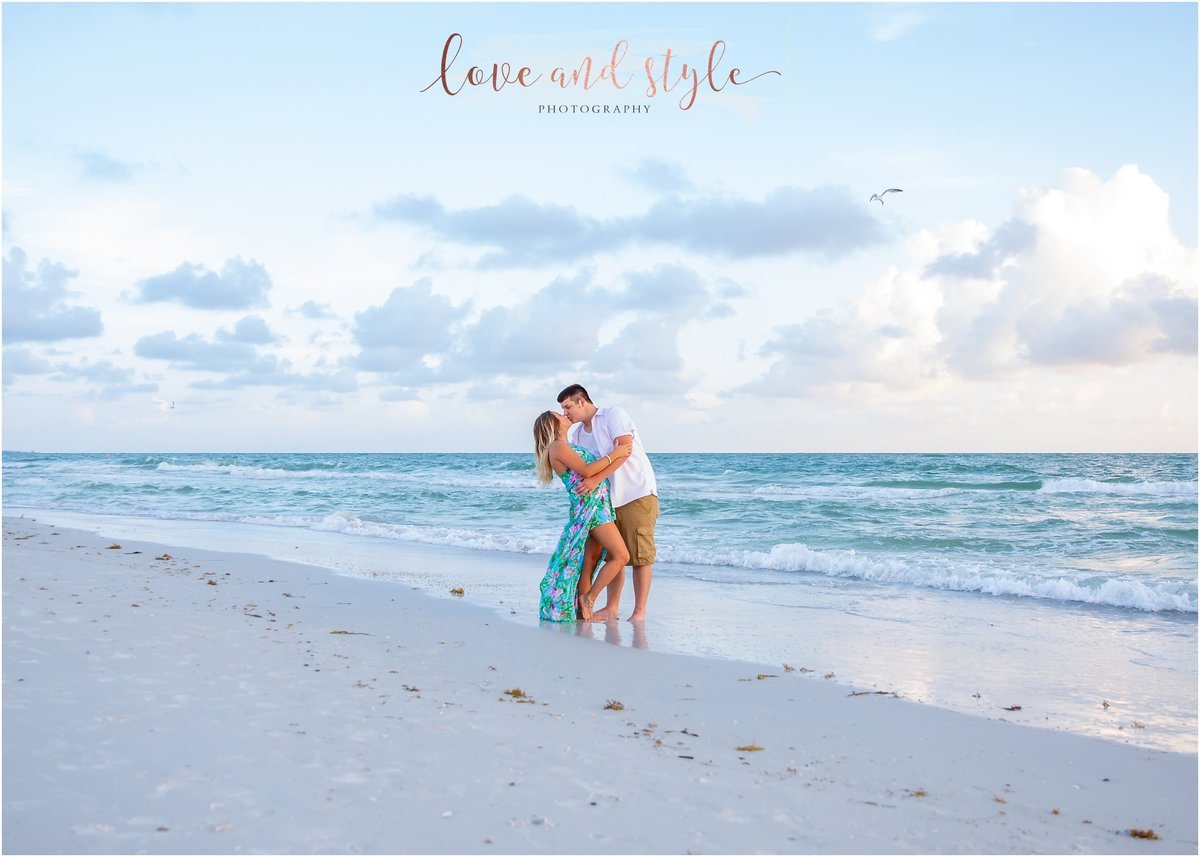 Engagement Photography at Bradenton Beach during sunset with couple kissing during sunset