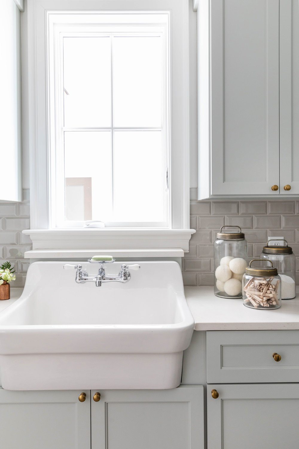 Sherwin-Williams-Silver-Strand-Laundry-Room-with-Kohler-Utility-Sink-and-Brick-Herringbone-Floor-3