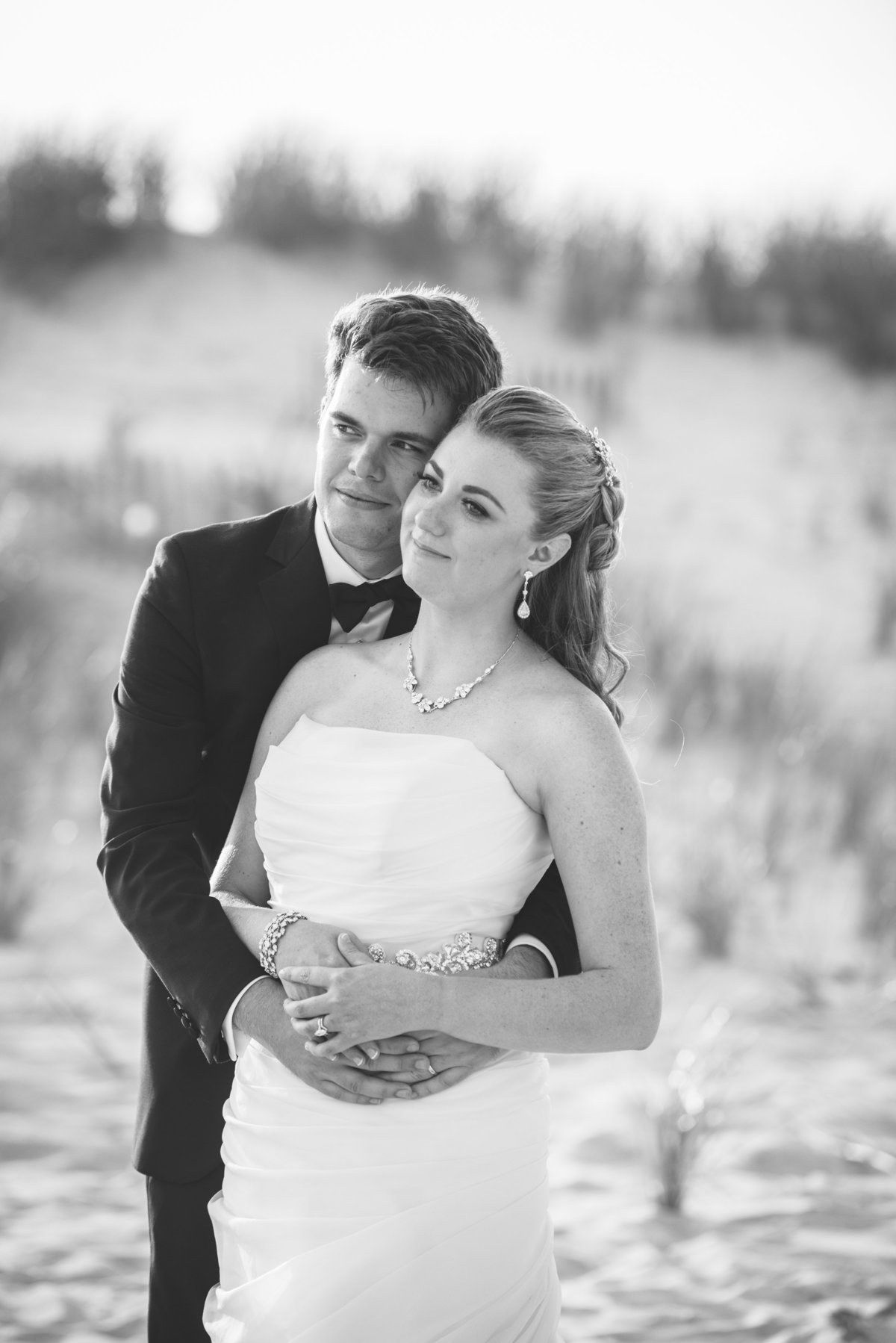 Black and white photo of bride and groom at the dunes of Oceanbleu
