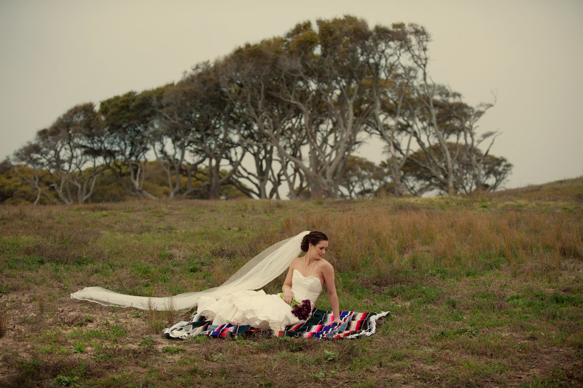 bridal portrait on mexican blanket at fort fisher