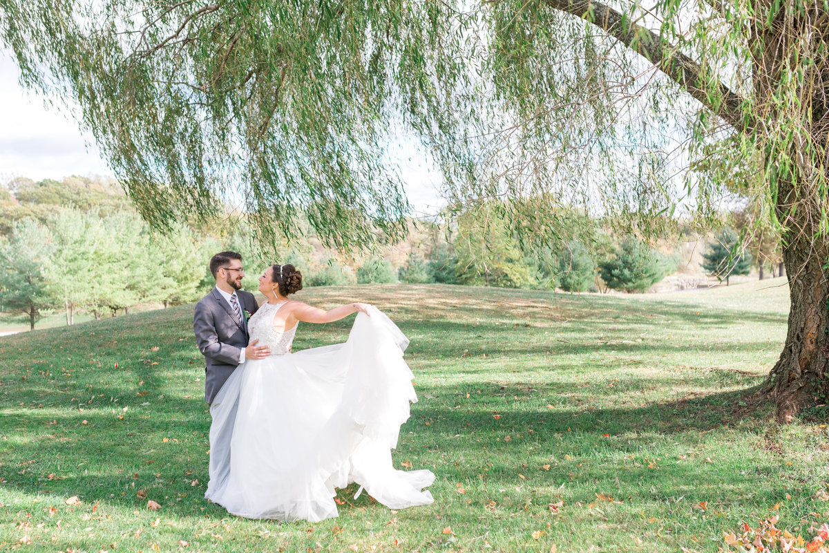 Couple dancing under a willow tree at the New York Country Club