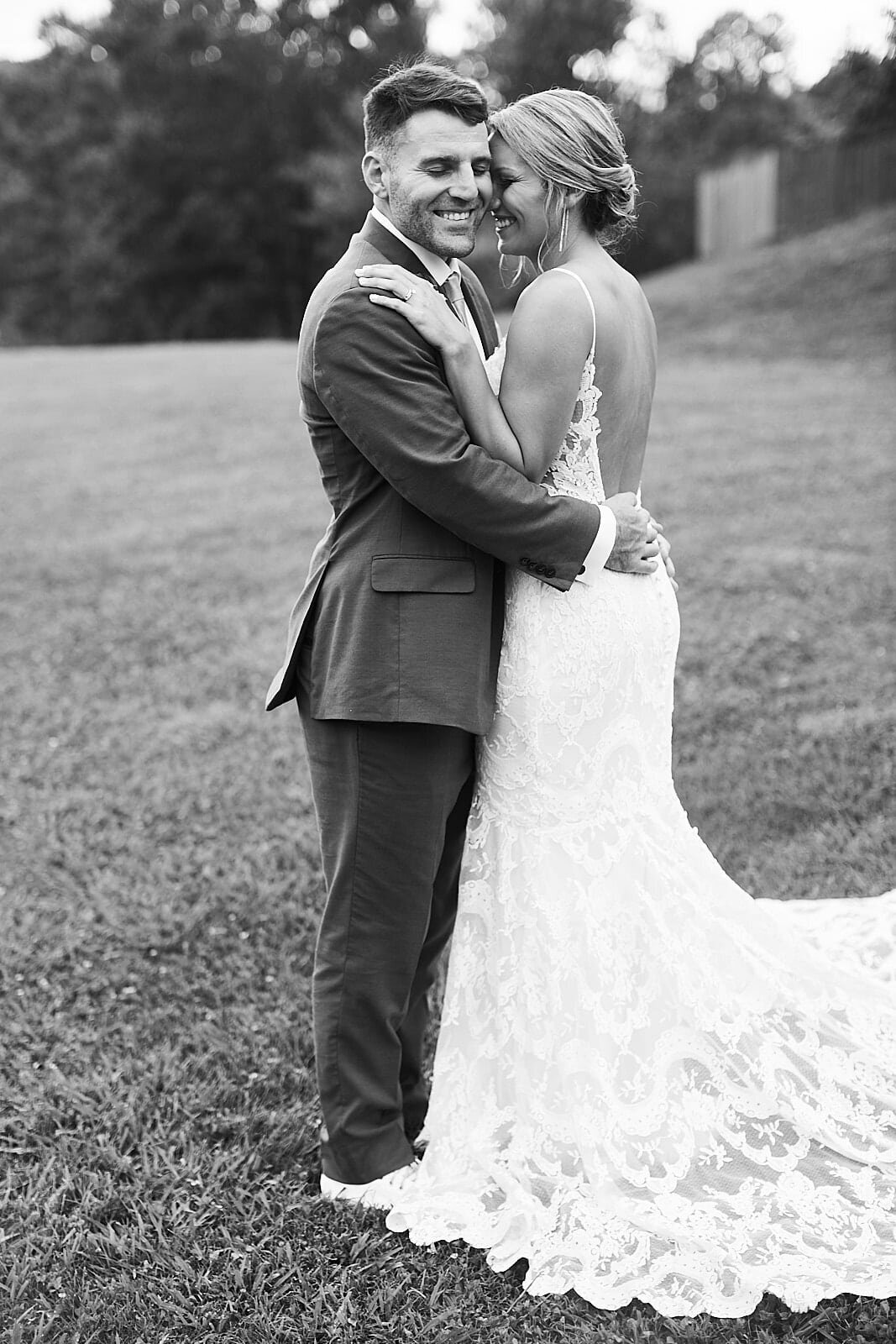 bride kisses groom on hill of willows farm georgia