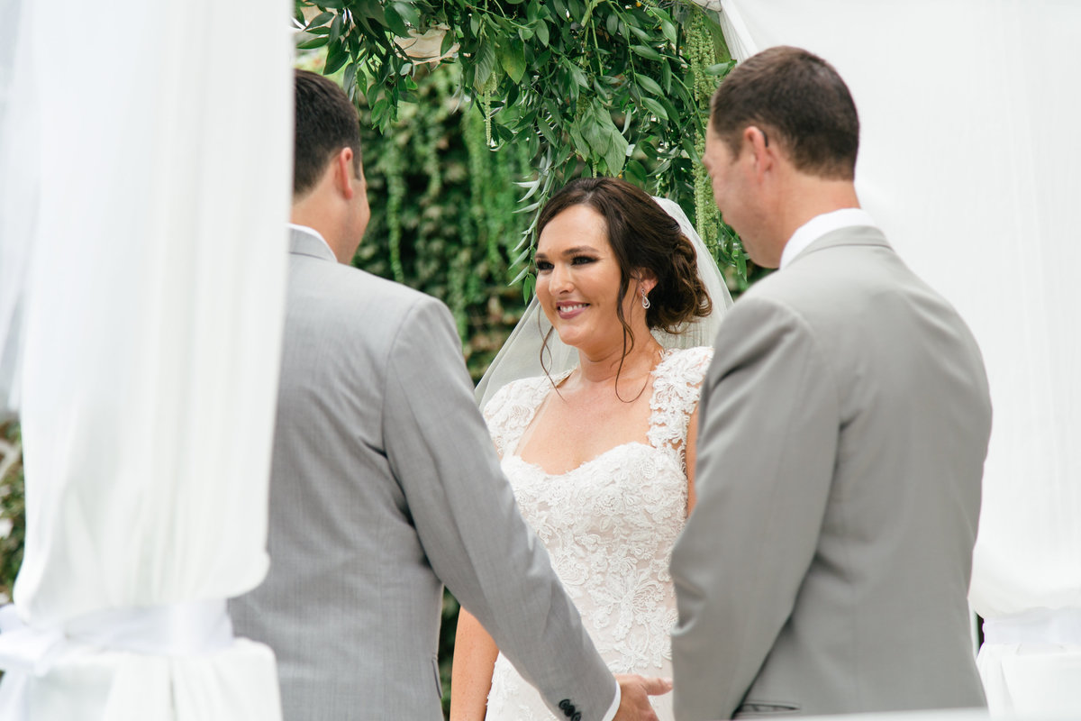 Bride and groom exchange vows at 1880 Union Hotel Wedding
