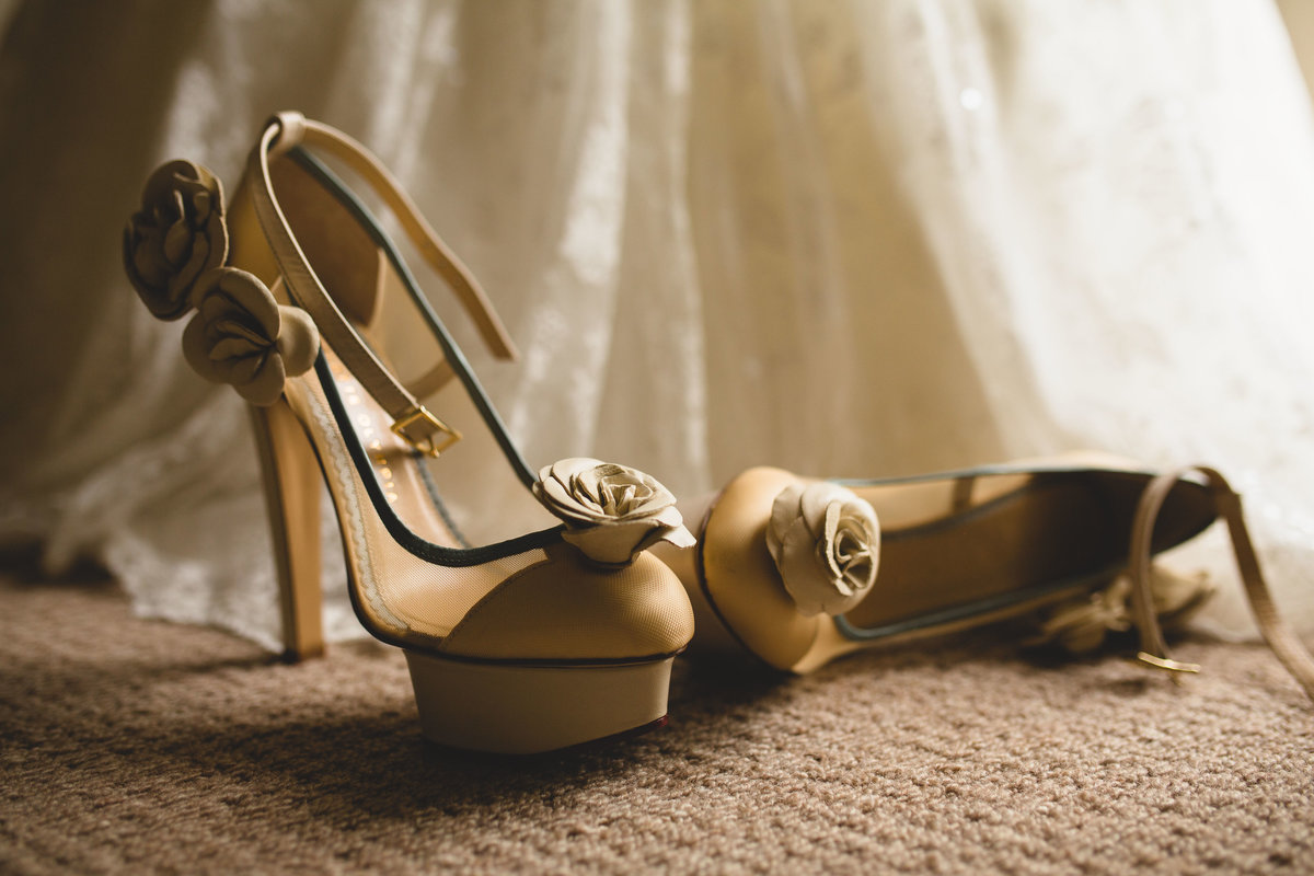 charlotte olympia wedding shoes with dress in background