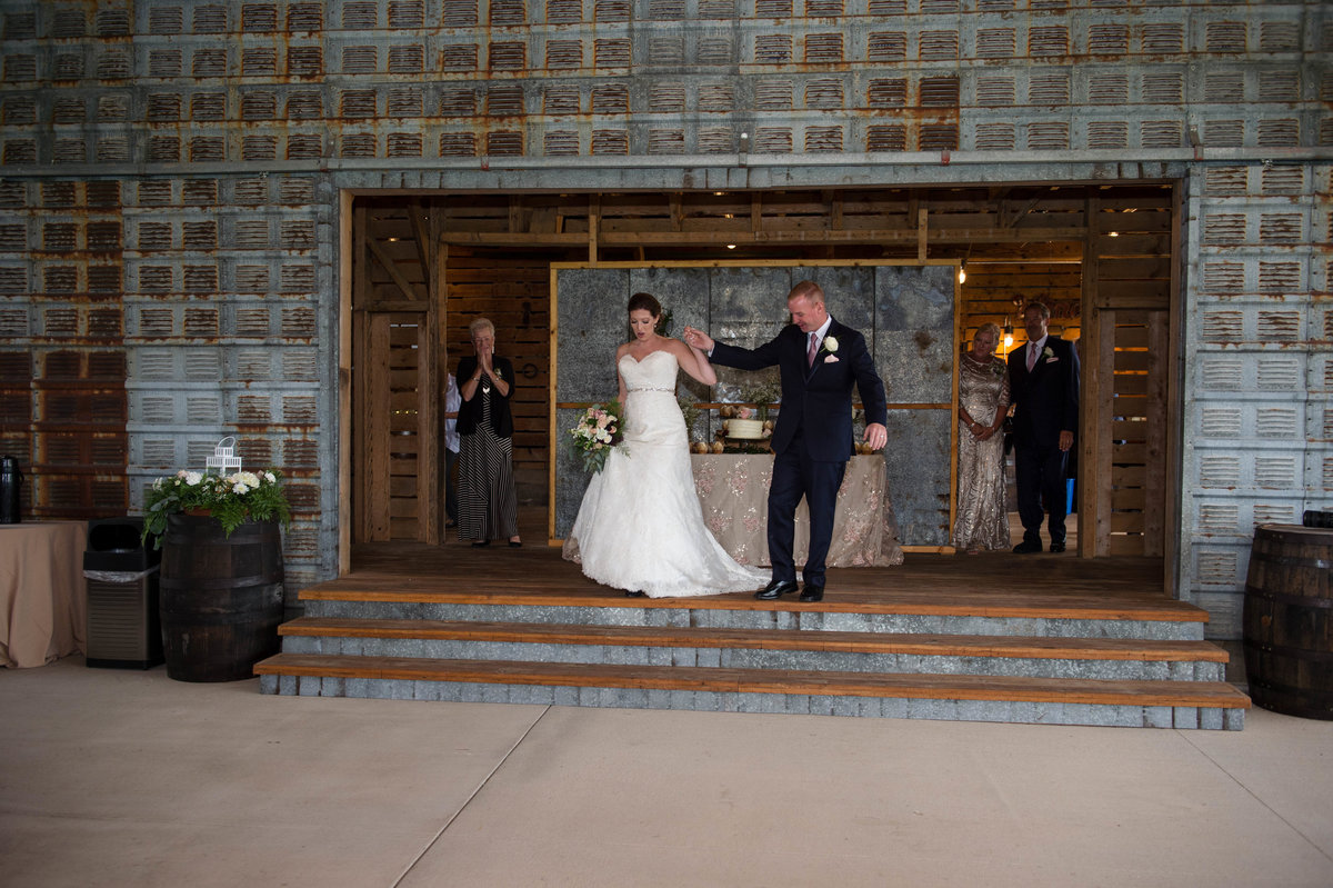 couple enter the reception space