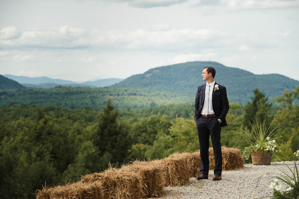 groom looking at the mountains