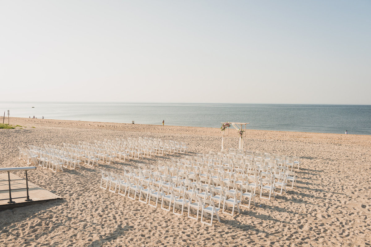 aerial photo of beach wedding ceremony set up at Pavilion at Sunken Meadow