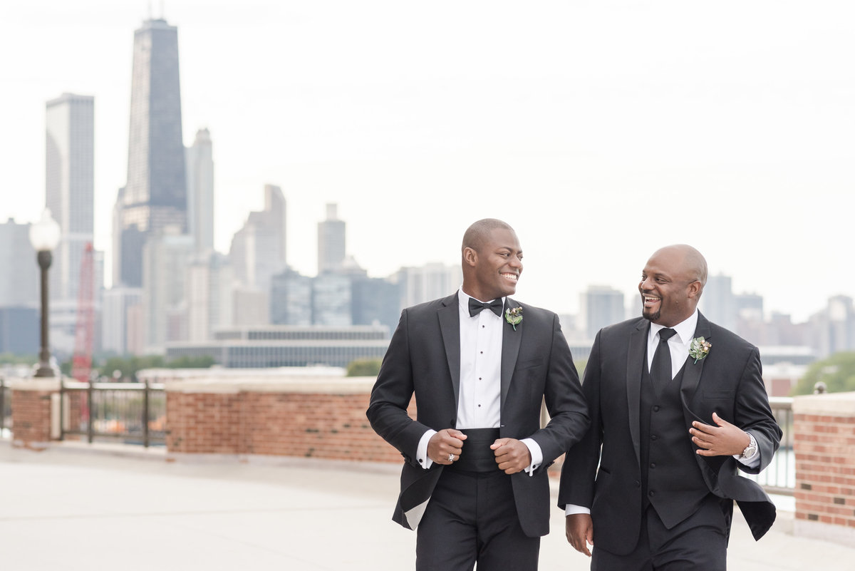 Groom and groomsmen Chicago navy pier skyline wedding