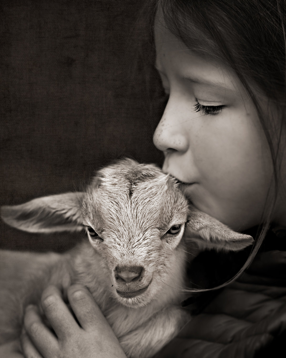 Portrait of girl with goat by Roslyn Family Photographe