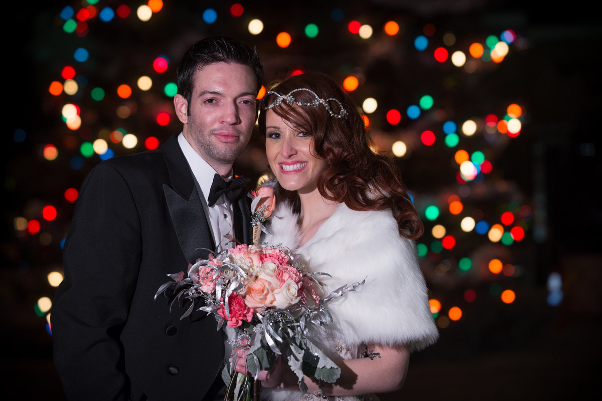 Colored Christmas lights bride and groom portrait