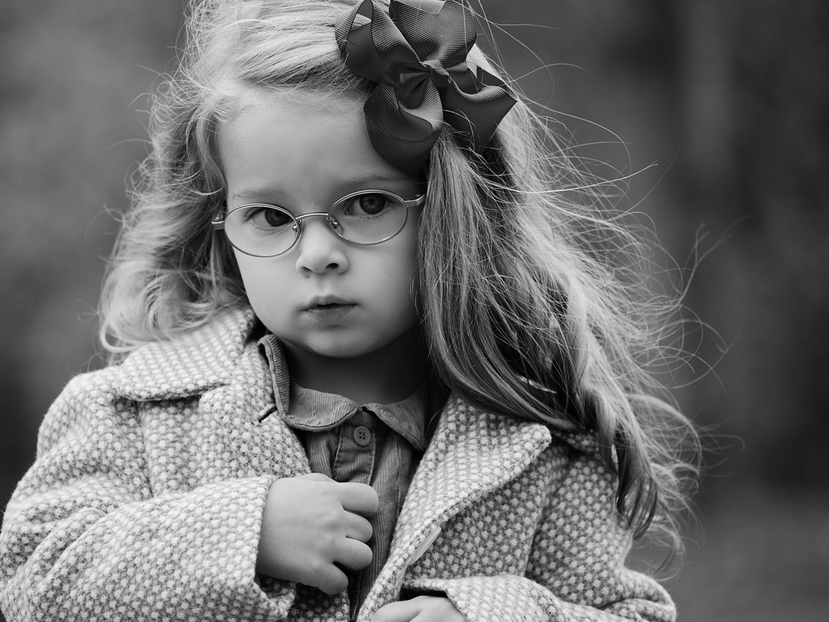 charlotte family photographer jamie lucido creates beautiful black and white portrait of a young girl in fall with her coat on