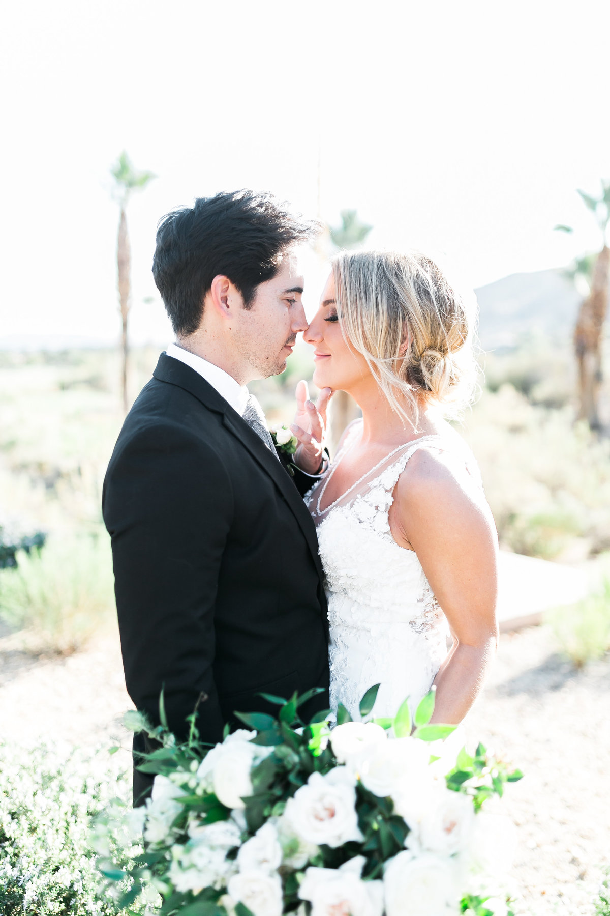 bride and groom at Red Rock Country Club with white floral bridal bouquet