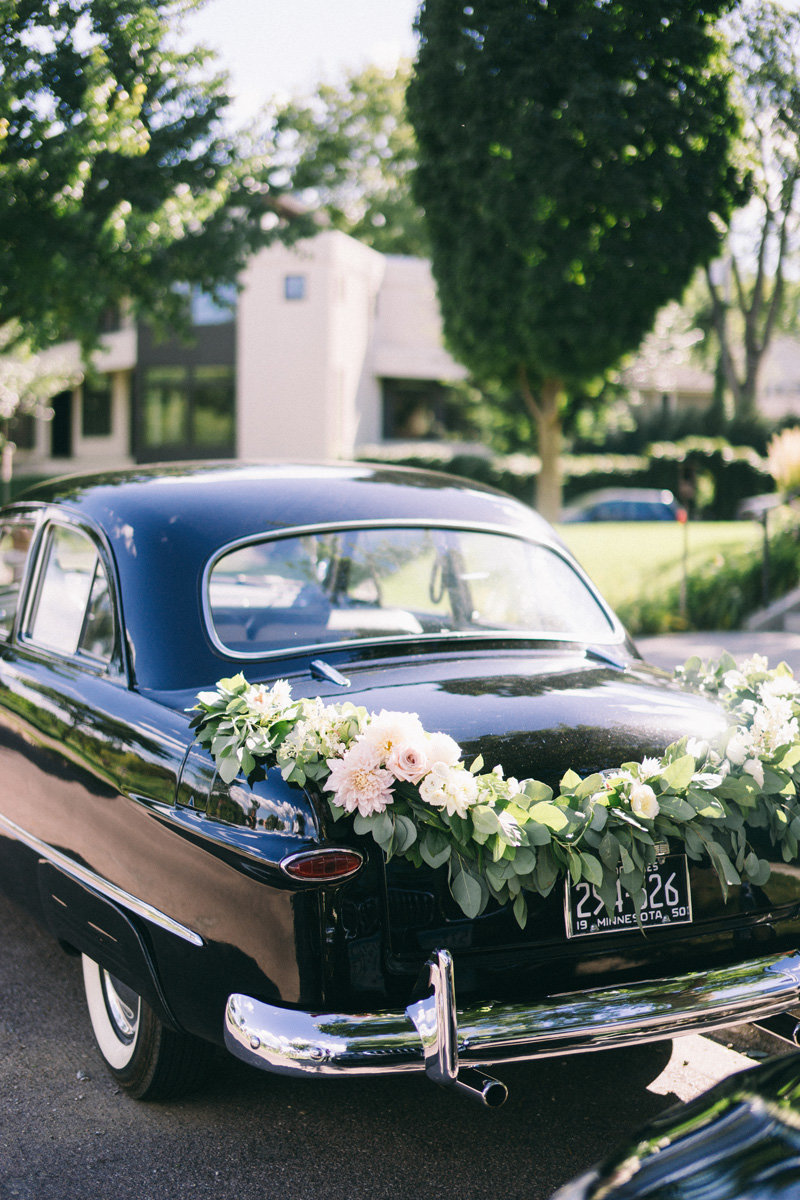 wedding flowers on a vintage car