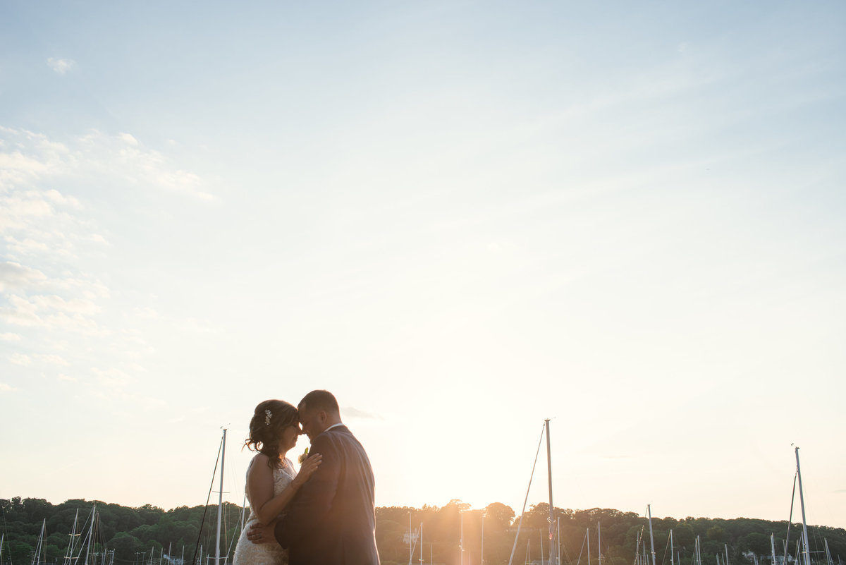 Bride and groom at Sunset at Harbor Club at prime