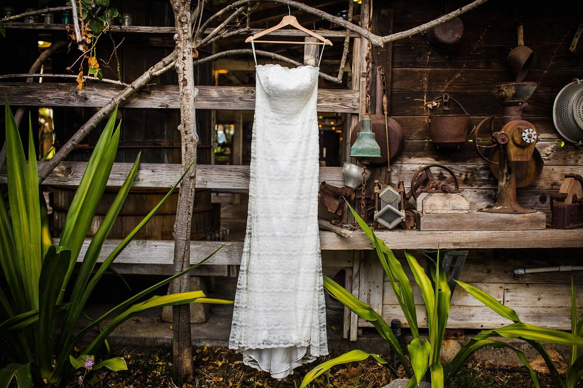 A wedding dress hangs at a San Diego wedding.