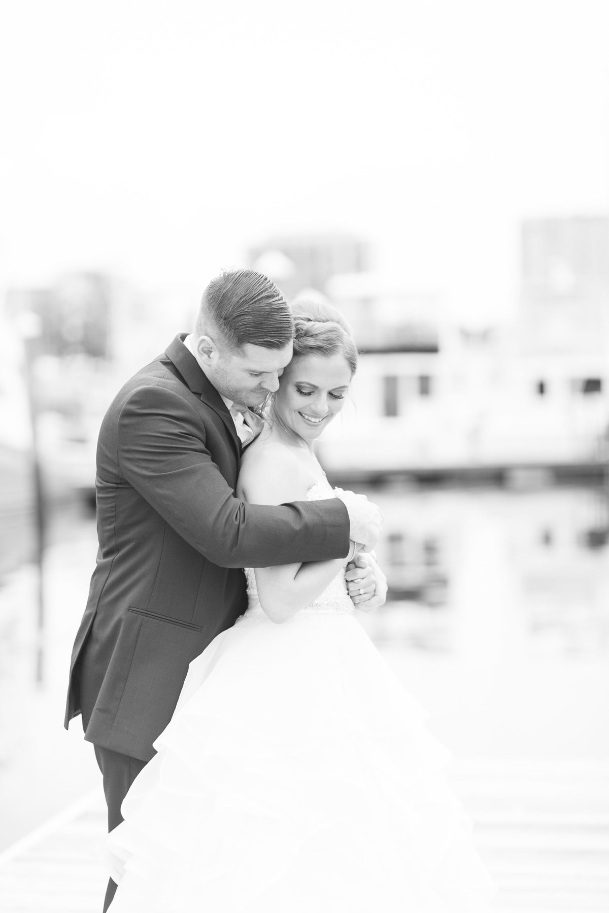 classic black and white image of bride and groom embracing