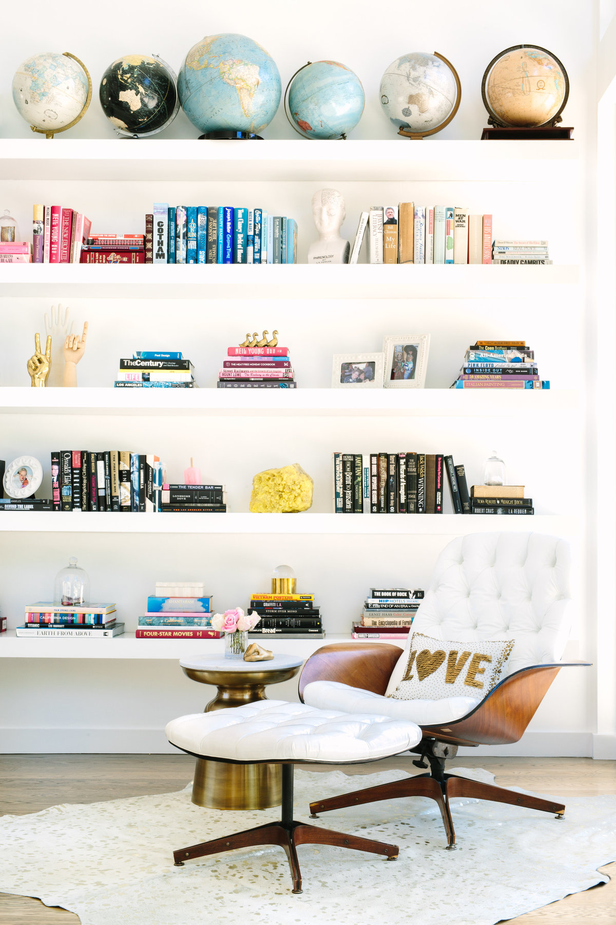 Modern floating bookcase with Plycraft lounge chair and vintage globe collections