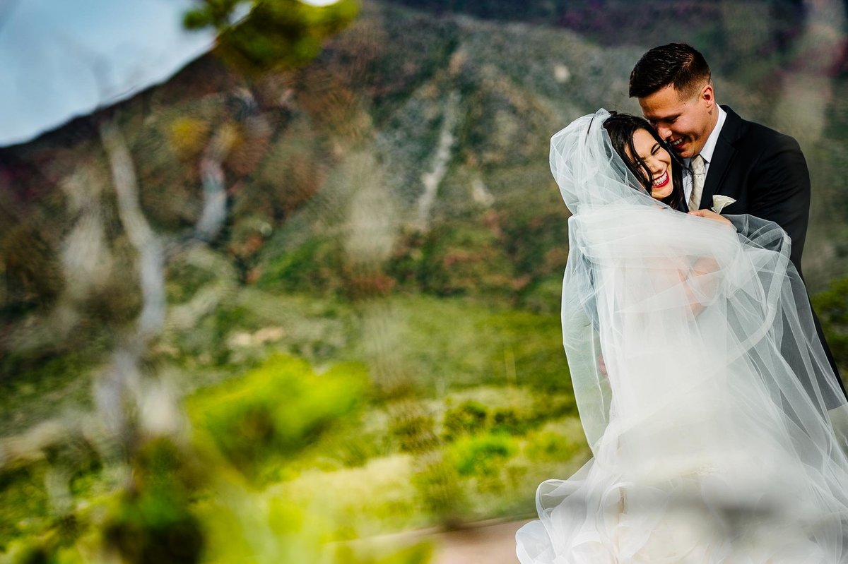 bride and groom portrait with franklin mountains in el paso by stephane lemaire photography