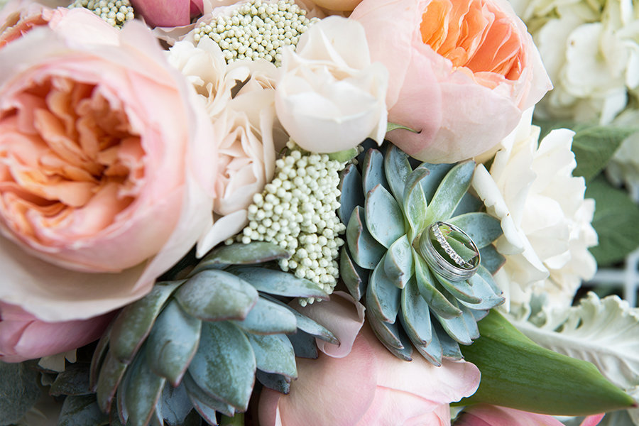 A bouquet with peonies and succulents, rings are included in this close up shot