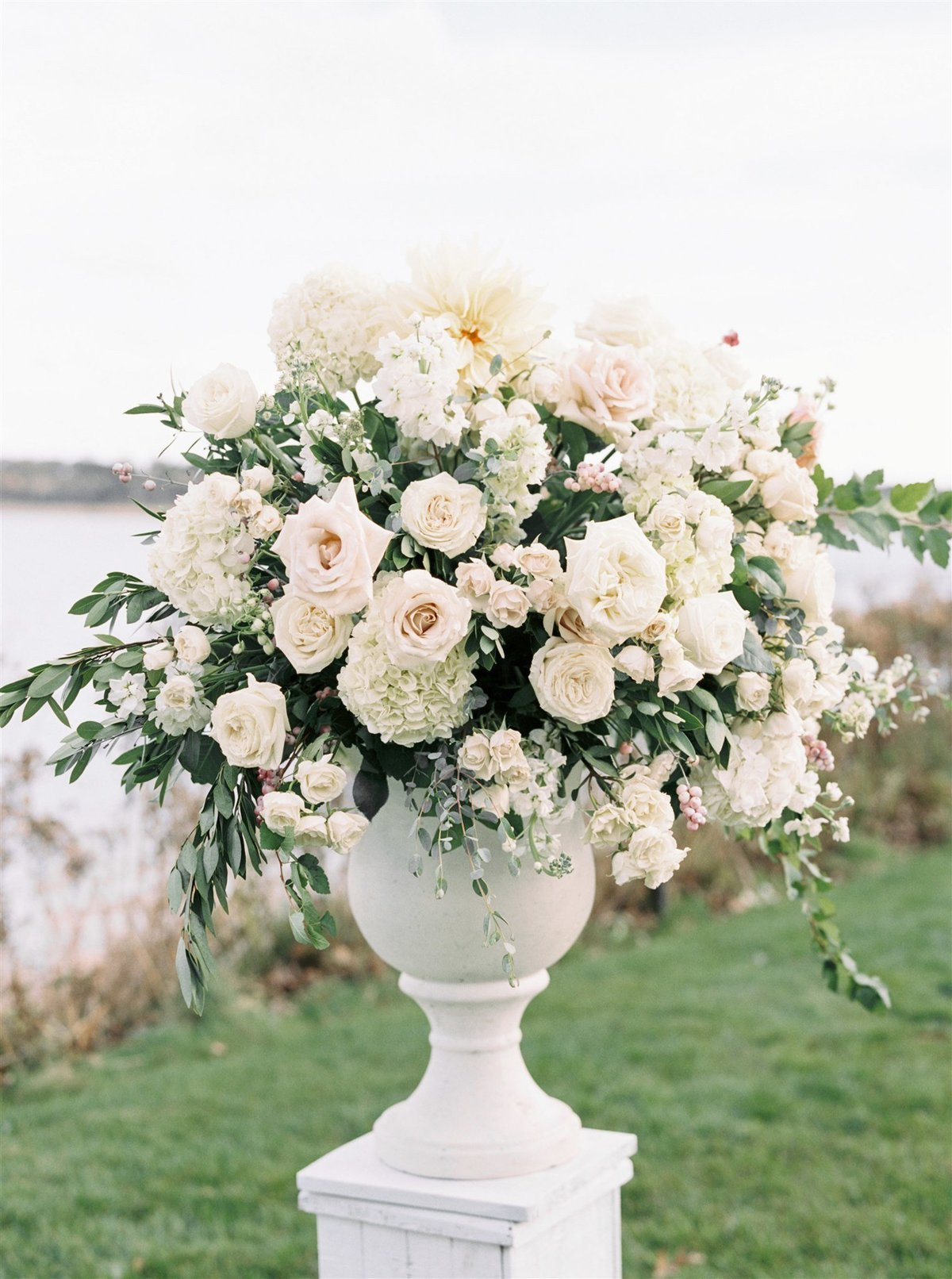 Overflowing white urn of roses and hydrangea for a Cape Cod Wedding by luxury Cape Cod wedding planner and designer Always Yours Events