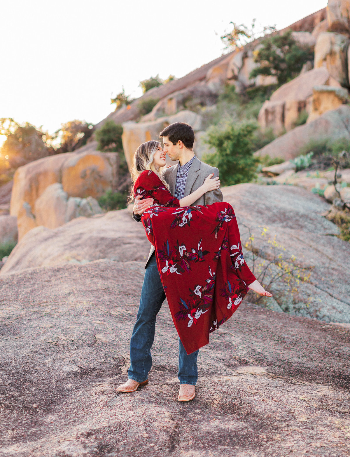 Engagement photo of Guy carrying girl