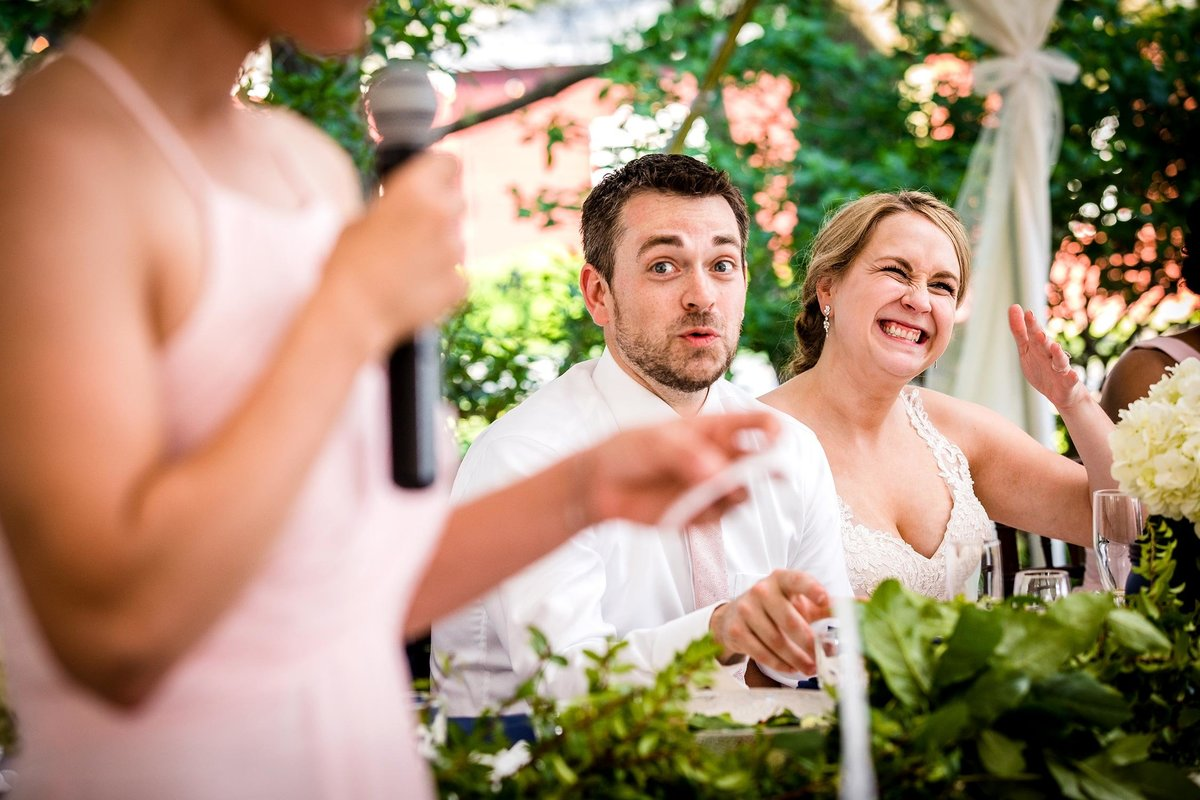 A couple reacts to a toast during an Oak Hill Farm wedding reception.
