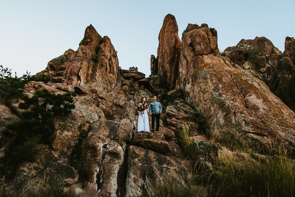 Couple on the rock formations at Settlers Park in Boulder, CO