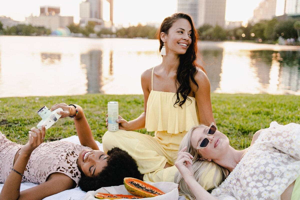 Lifestyle picnic photography for SkinTe Collagen Sparkling Tea by Alex Perry