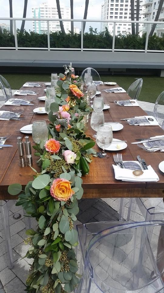 W Hotel greenery garland with free spirit roses farm table