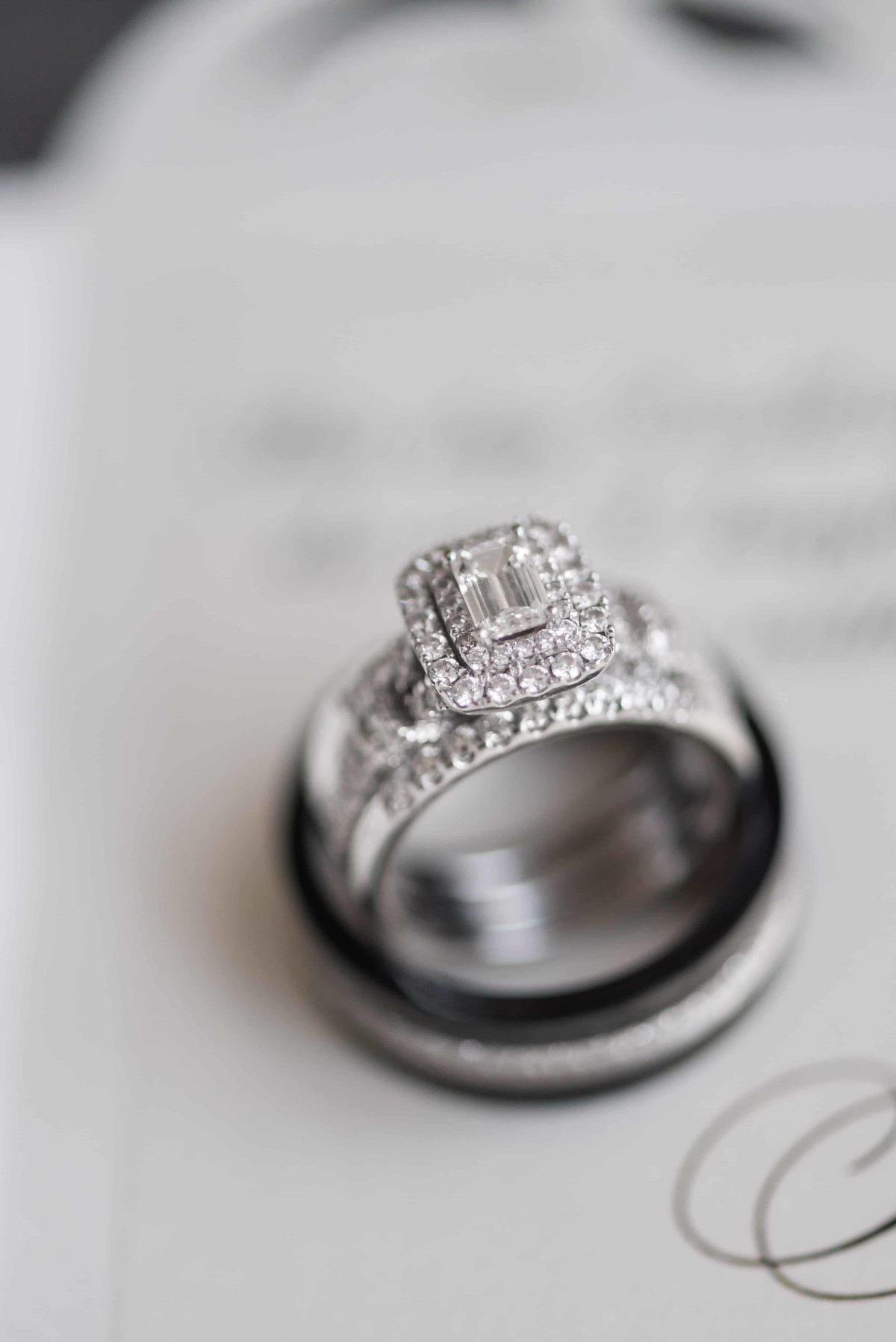 Macro detailed shot of couples wedding rings.