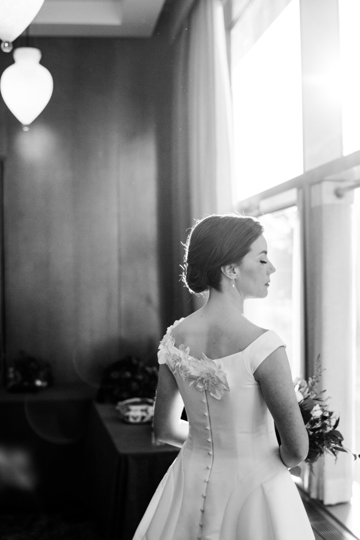Bride in Ritz hotel in black and white