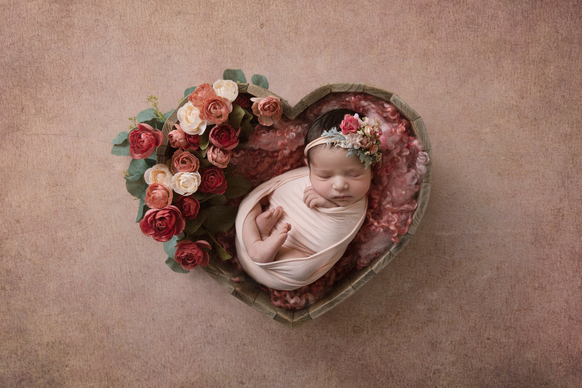 Little girl in a heart shaped bowl