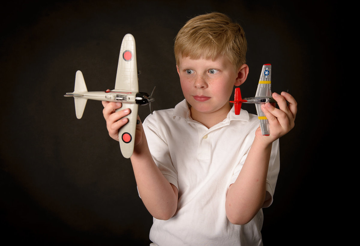 Boy with toy airplanes