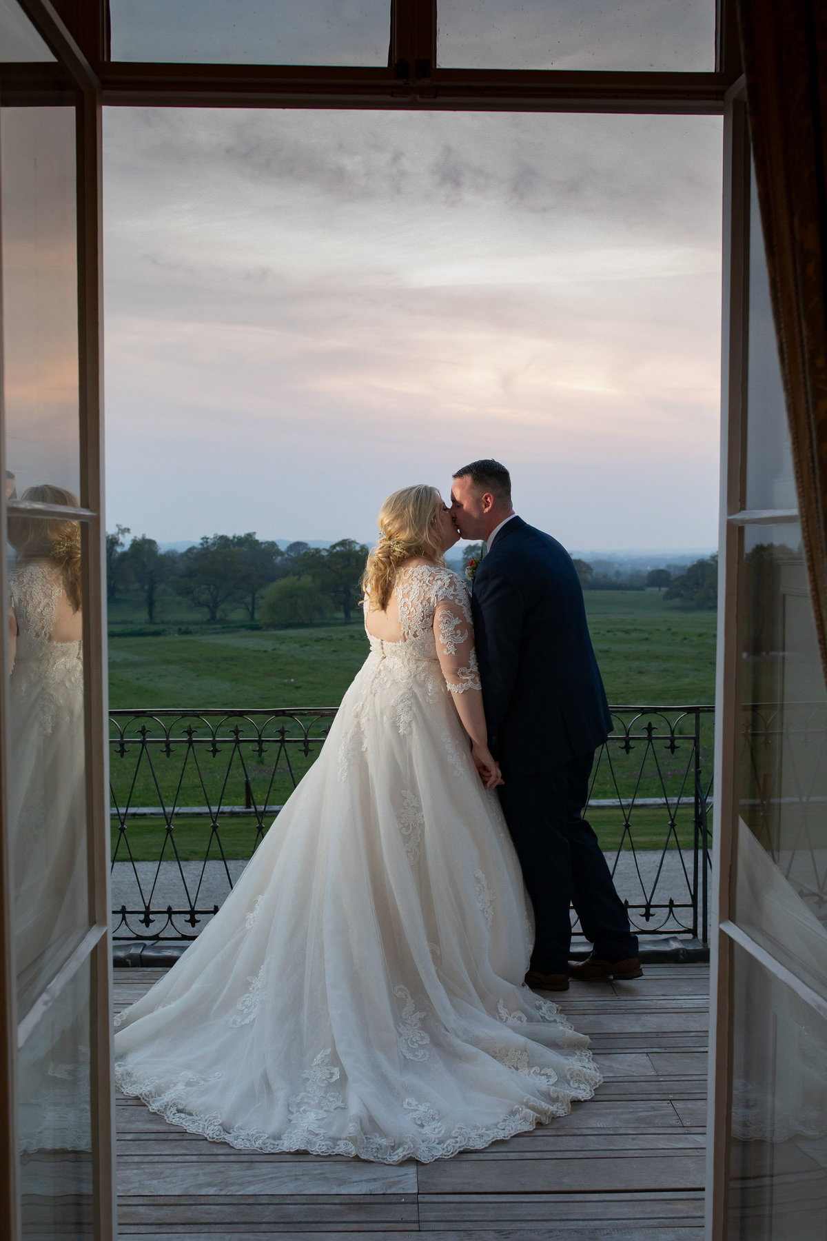 Bride and Groom at Sunset at Rockbeare Manor balcony_