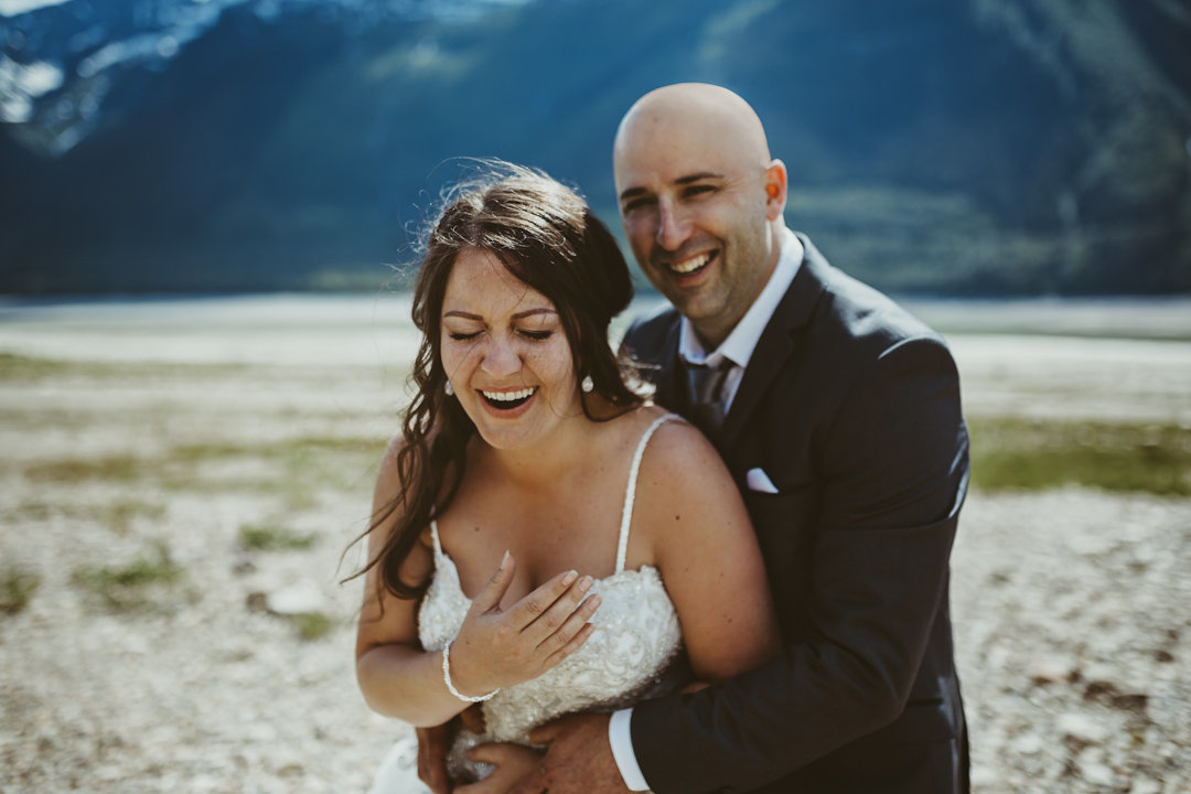 Laughing bride and groom in wedding photography in Valemount BC