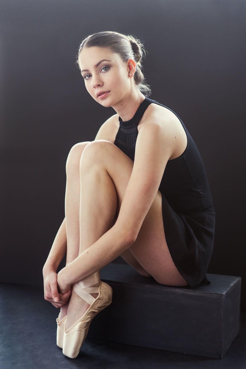 Briana poses in her pointe shoes for her high school senior photos