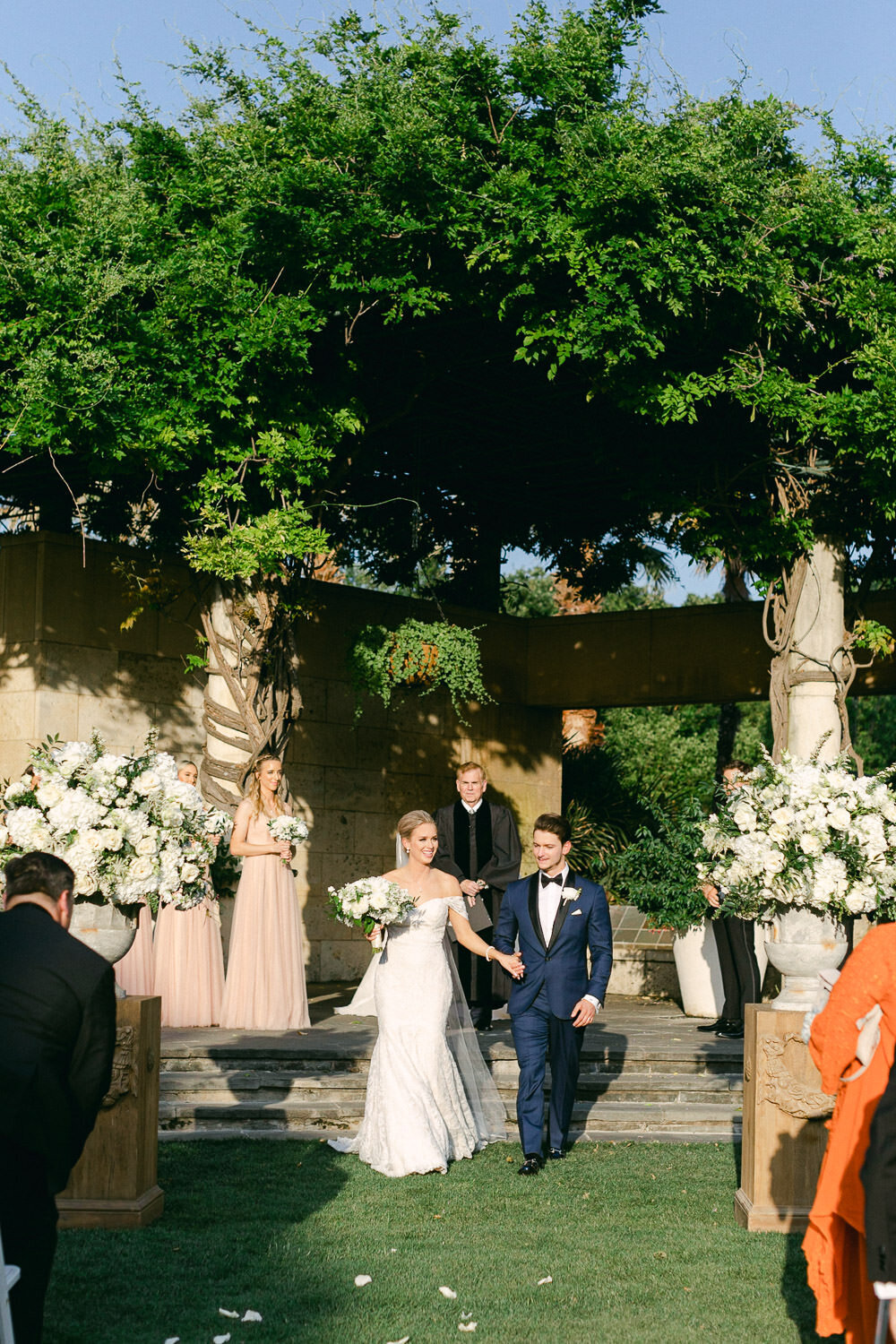 Bride and groom recessional laughing at ceremony altar Dallas Arboretum wedding black and white