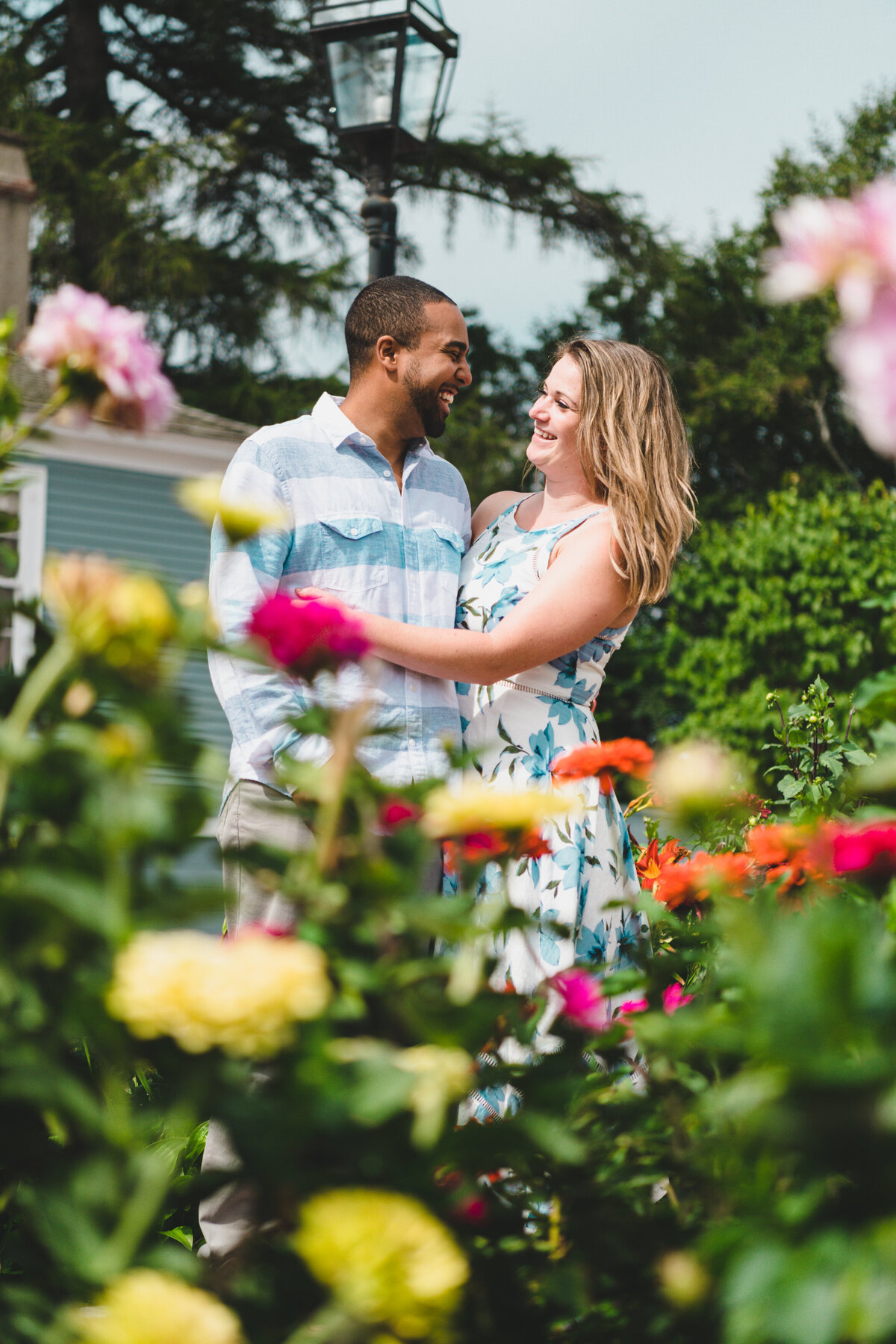 New Hampshire engagement session outdoor with flowers