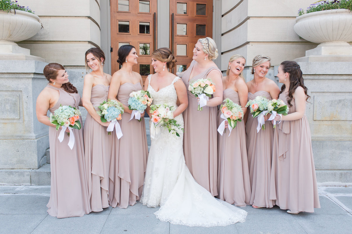 beautiful bridesmaids and bride in front of Slover Library