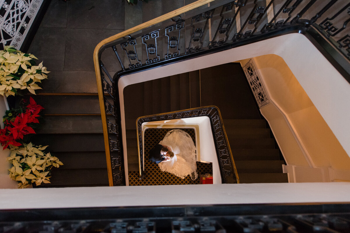photo of bride and groom from the top of the staircase from wedding at The Carltun