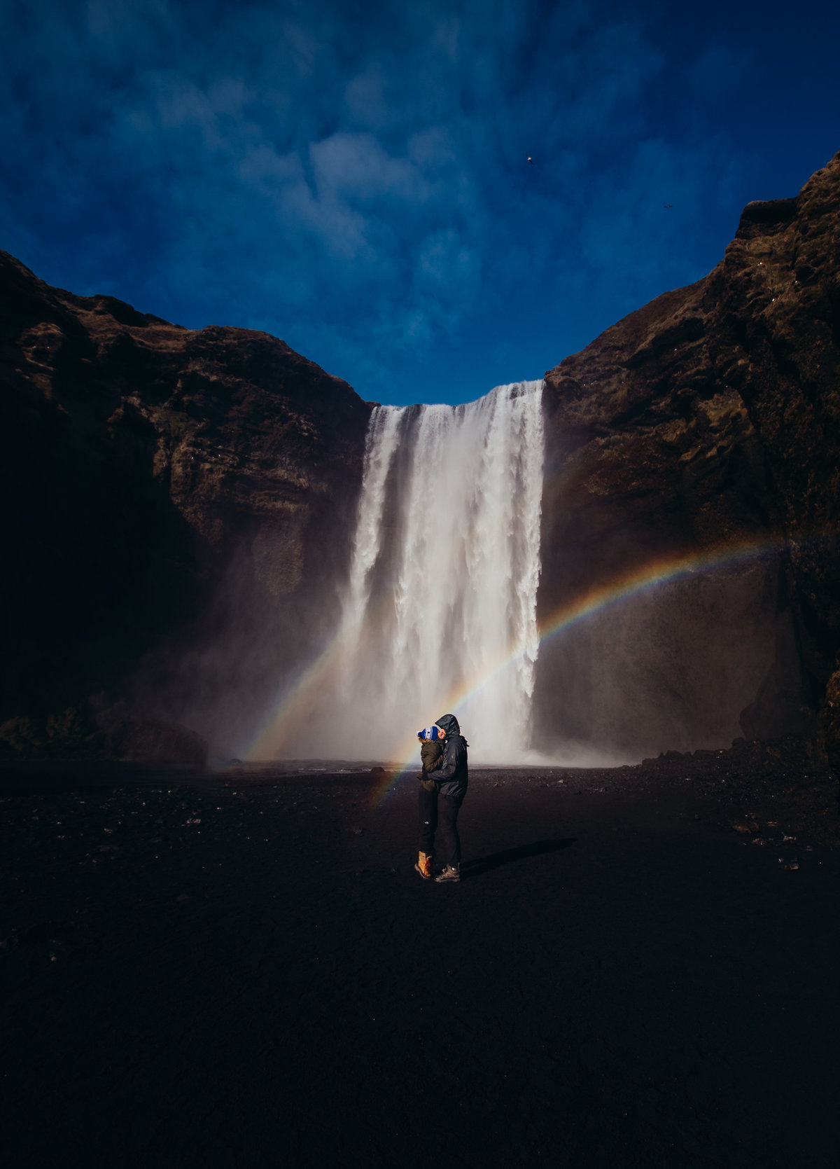 Couples proposal at Skogafoss in Iceland