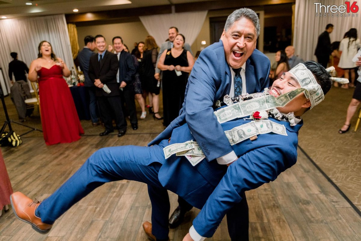 Man dips the Groom during the Money Dance